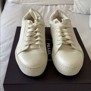 Report white faux leather sneakers